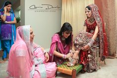 bride groom punjabi wedding photography lehnga red