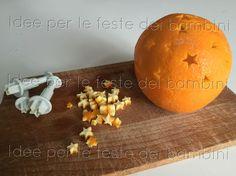 Candelina decorativa fatta con buccia d'arancia e olio