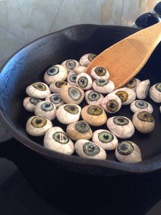 "Painted rock eyeballs by Claire: cover for Halloween cookbook ""Bubble Bubble Toil and Trouble, volume I I."