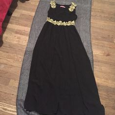 Gorgeous Long Dress This dress is the perfect fairy tale dress in black, Gold Lace detail in the middle and shoulder strap, zipper on the side, great condition, perfect for an elegant occasion Dresses