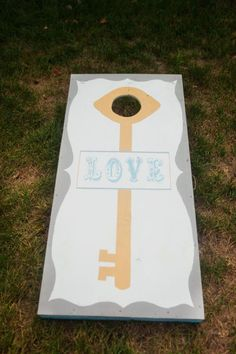 Cornhole!! What a wonderful outdoor activity for your guests to enjoy! Love how they painted the boards to match their wedding theme