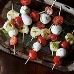 Tortellini Caprese Bites {your fave tortellini, cherry tomatoes, fresh mozz and basil} = Perfect appetizer for any party you are hosting!  For a no carb option, just remove the tortellini - We like to add an artichoke heart to each sometimes!