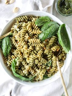 Whole wheat pasta salad tossed with pistachio basil pesto and burrata cheese! Serve this hot or cold - it's perfect at picnics and parties.