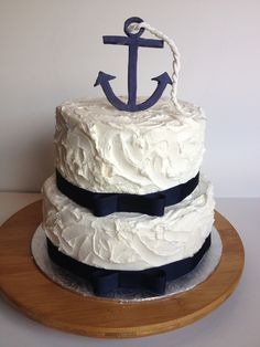Nautical Themed Buttercream Cake. Anchor and rope made with modeling chocolate. From iheartcupcakesblog.wordpress.com.