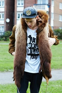 Street fur. Mix it up with a baseball cap for council house chic. This parka is amazing. Luxe. Or should I say luxetaposition?