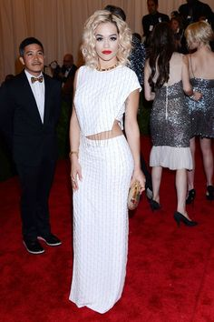 Rita Ora at the Met Gala  Wearing a faux-wrap, midriff-baring frock by Thakoon, Rita Ora puts punk on hold and goes glamorous.