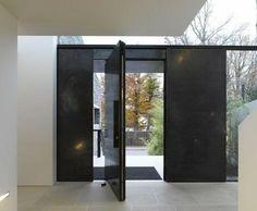 black steel pivot door in Haus M by Titus Bernhard Architects
