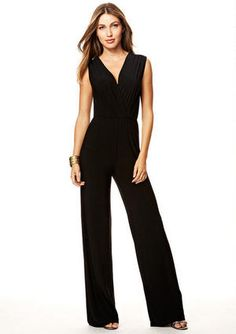 Surplice jumpsuit with wide leg opening and pleated neckline. Styled with Nola Skinny Belt (177395)
