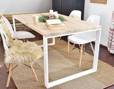 Modern Industrial vintage style dining table made from solid oak wood and white steel thats over 100 years old. A solid and soulful piece of organic furniture that has been lovingly handcrafted using the finest reclaimed materials. The wood used in the piece is oak, a fantastic