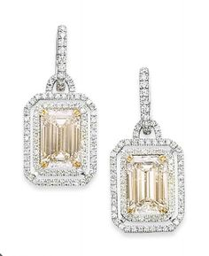 A PAIR OF DIAMOND EARRINGS   Set with two rectangular-cut diamonds, weighing 5.13 and 5.06 carats, each in a micro-pavé double row, to the diamond-set suspension loop, mounted in gold, size 3.5 cm