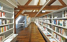 GGG City Library, Basel The modern library in old Schmiedenhof Photo: © Lilli Kehl, Basel Interior Design And Space Planning, City Library, Hotel Architecture, Modern Library, Basel, Refurbishment, Stairs, Shelves, Building