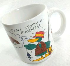 Fish Story In Progress Coffee Mug American Greetings 1987 cartoon duck 60201 #AmericanGreetingsDesignersCollection1987 #FishStoryInProgressfishingfishermanDuck