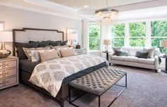 Pillows and patterns perfectly adorn this lovely, restful master bedroom. | Pulte Homes