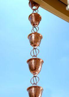 Monarch's Pure Copper Hand Hammered cup with Ring rain chain in 8.5 feet. The hammered finish enhances the look in a timeless fashion and complemented with double loops for a unique hybrid of classic and contemporary elements.