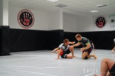 The project for BJJ Zgorzelec club aimed for transforming previously located there fitness club into Brazilian Jiu-Jitsu gym. First we removed mirrors (a threat to trainees) and unified the colors. 100m2 of the floor and the walls is now protected with a grey and black mat matching the colors of the club. Simple in design room...  Read more » Jiu Jitsu Gym, Design Room, Brazilian Jiu Jitsu, Bergen, Mirrors, How To Remove, Walls, Floor, Club