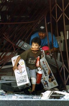 The 1992 Los Angeles riots a young boy helps his father loot a Big 5. Stocking up on thigh-masters
