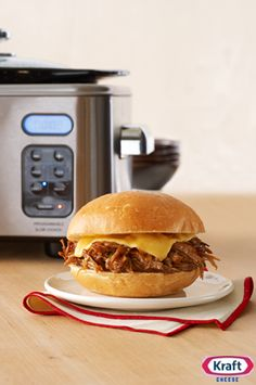 Slow Cooker BBQ Pork Sandwiches - You're only five ingredients away from serving these saucy sandwiches at your next party