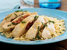 Feta, Herb, and Sun-Dried Tomato-Stuffed Chicken | Sun-dried tomatoes and fresh basil really bring out the flavors of this feta-stuffed chicken breast. For more ways to cook stuffed chicken, see our complete stuffed chicken recipe collection.
