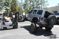 Silver Fox - 2013 10th Anniversary Rebelcon: Rear-side view of the vehicle being flexed with forklift