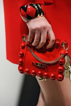 tinaschoices:      Moschino Fall 2012 RTW Details Michael Kors Handbags Outlet, Cheap Handbags, Purses And Handbags, Fashion Handbags, Gucci Purses, Or Rouge, Red Bags, Metal Bracelets, Shades Of Red