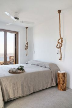 Gorgeous rope and wood accents create a beachy feel.