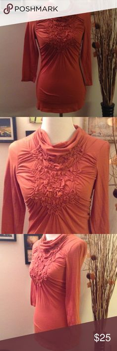 DELETTA Orange Brown Ruffle Mock Neck Top ANTHROPOLOGIE DELETTA Orange Brown Ruffle Mock Neck Top. Size XS. 3/4 Sleeves. Thin and lightweight. Stretchy. Bust is 26 inches, sleeve is 17.5 inches, length is 24 inches. Cotton/Polyester/Spandex. Anthropologie Tops Blouses