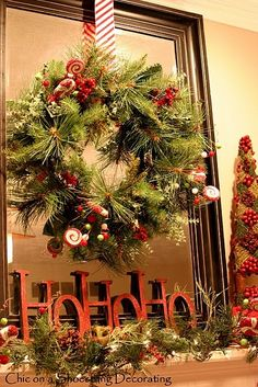 Wreath in front of mirror or put it in empty frame with letters at bottom.