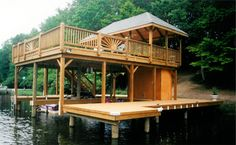 boat house, boat dock, sunbathing deck, and entertainment pavillion built on lake chesdin virginia