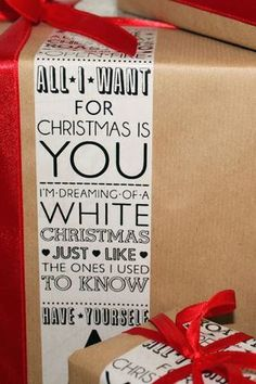 "Christmas wrapping with a strip of lyrics-cute! Except I will NEVER use ""All I Want for Christmas is You"" EVER."