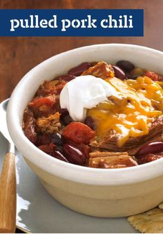 Pulled Pork Chili — Tomatoes, beans and a meaty boneless pork shoulder get a good, long simmer in the slow cooker to make this Pulled Pork Chili recipe for a crowd. Chili Recipe For A Crowd, Pork Chili Recipe, Food For A Crowd, Chili Recipes, Pork Recipes, Lunch Recipes, Delicious Recipes, Crock Pot Recipes, Crock Pot Cooking