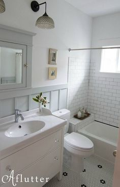 Digging the retro look of the penny tiles in this bathroom.  Sarah Richardson's inspiration.  Look up this make-over for advice.