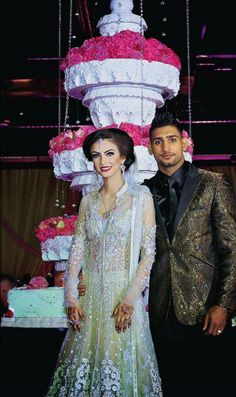 Amir Khan and wife Faryal Makhdoom at their walima and 14ft cake! Faryal in Tarun Tahiliani.