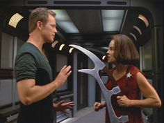 Tom Paris and B'Elanna Torres. I haven't seen enough Voyager to know if they actually become a couple, but this photo makes me want to find out!
