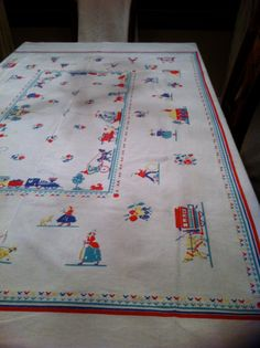 The center would make a great pillow and the rest would also make great pillows -- Vintage Linen 1950's Tablecloth by Questers on Etsy, $48.00