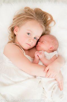 newborn and sister portrait.