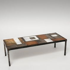 Roger Capron - Coffee table, circa 1960 Glazed ceramic tiles.   http://www.galerieriviera.com