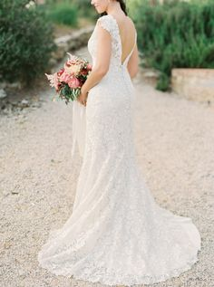 Full lace Allure Bridals wedding gown: http://www.stylemepretty.com/2015/09/29/tuscany-outdoor-spring-wedding/ Photography: Sarah Kate - http://sarahkatephoto.com/ #sponsored