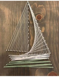 Welcome to my shop! Im a mother of two taking advantage of nap-time by creating amazing conversational piece string art. Each piece is cut, sanded, stained by me, customized by you and enjoyed by all. - Simple Sail Boat - With a clean crisp design this is timeless piece to go with