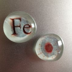 """Glass bead magnets featuring the chemical symbol and electron shell for today's #30DOC theme, """"Iron"""""""