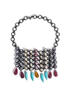 Dannijo blend industrial technique with bohemian sensibility via the Halsey bib necklace. Multicoloured marbled beads sit within a gunmental base, with bright, resin stones hanging delicately from its base.