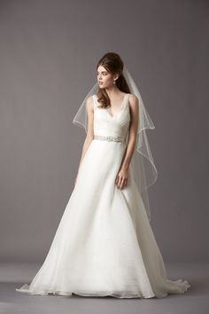 If strapless, high neck or halter doesn't float your boat, why not choose from one of these gorgeous V-neck bridal gowns for your wedding day