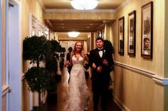 Bride and groom enter their wedding reception at La Louisiane Bar & Catering Venue. Photo credit: www.LaurieForetPhotography.com