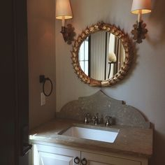 Bathroom vanity with arabesque styled marble back splash.  chelseafrazerrobinson's photo on Instagram