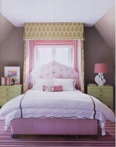 pink and green bedroom, bed in front of window. Like the box on top of the curtains.