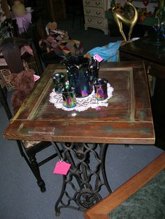 A Re-Purposed table constructed from a wooden door atop an antique Singer Sewing machine base. This functional, unique, and attractive table is in Booth 116 at the KC Brass Armadillo. Call us at We can ship stuff too! Sewing Machine Drawers, Sewing Machine Tables, Sewing Machine Projects, Treadle Sewing Machines, Sewing Table, Vintage Crafts, Vintage Sewing, Furniture Makeover, Diy Furniture