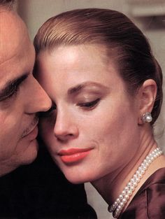 Grace Kelly and Prince Rainier in one of a series of engagement portraits taken by Howell Conant in Grace's New York apartment.