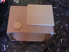 HOW TO CREATE A GoPro COSTUME: - Step 1) Find a Box and some cardboards to realize the details. If your box is not rigid enough, reinfoce it adding some triangular cardboard in each angle. I used plenty of hot glue.