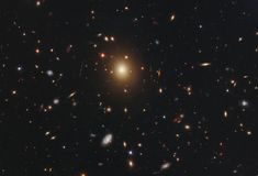 The giant elliptical galaxy in the centre of this image, taken by the NASA/ESA Hubble Space Telescope, is the most massive and brightest member of the galaxy cluster Abell Maquillaje Sugar Skull, Solar Mass, Hubble Images, Andromeda Galaxy, Hubble Space Telescope, Nasa Space, Space Photos, Image Of The Day, Light Year