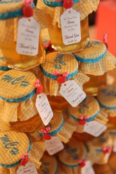 Honey jar with monogrammed covers as wedding favors. Aqua, yellow and coral wedding