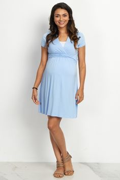 Look no further for a cute maternity/nursing dress you can look and feel great in. This classic draped front style makes nursing easy with a v-neckline and a cinched under bust style gives you a flattering silhouette while showing off you bump. Style this dress with maternity leggings and flats or boots for a perfect casual outfit.
